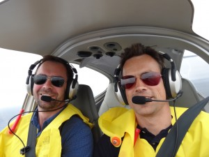 All smiles as we are passing over the English channel just below the clouds at 500 feet, low enough to wave to the sailors ploughing through the high seas.
